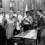 From left to right - Charlie Barnett, Tommy Dorsey, Benny Goodman, Louis Armstrong, Lionel Hampton