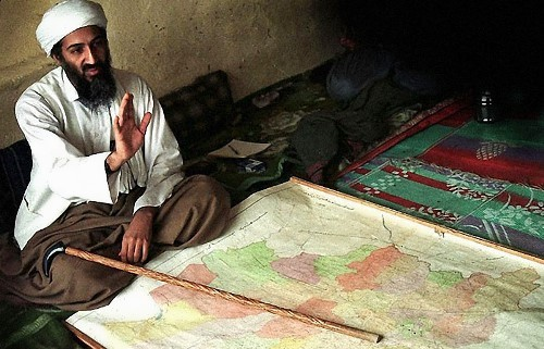 Osama with the map of Afghanistan in 1998