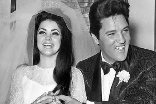 Priscilla and Elvis Presley at their wedding