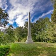 A memorial obelisk at Rockefeller's grave in Lakeview Cemetery, Cleveland, Ohio