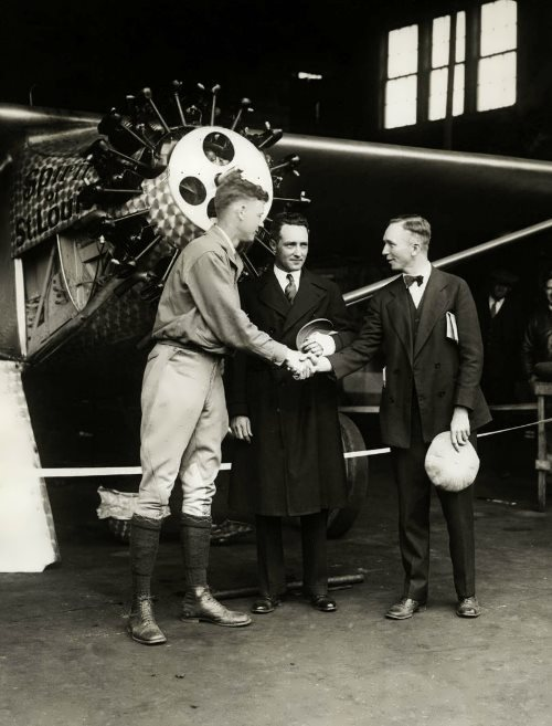 Lindberg accepts congratulations near his plane