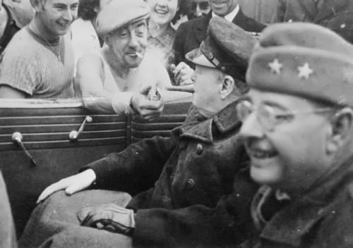 The French worker is giving a light to Churchill. Cherbourg, 1944