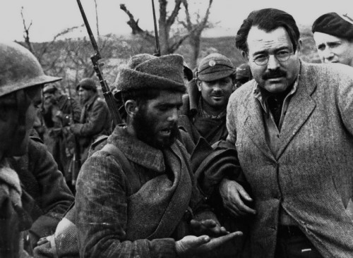 Hemingway with Republican soldiers on the front lines. Spain, December, 1937