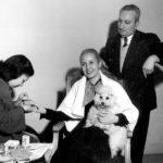 Eva, her barber, manicurists and pet dog