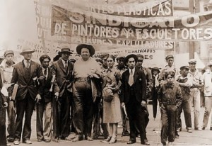Photo by T. Modotti . Diego Rivera and Frida Kahlo at the May Day demonstration, 1929