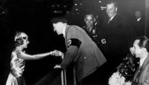 Adolf Hitler shakes hands with figure skater Sonja Henie