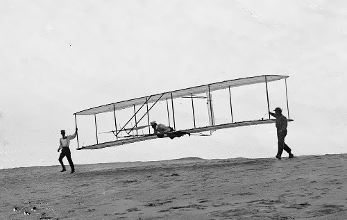 One of the first human flights. Wilbur holds and Orville flies. October 10, 1902