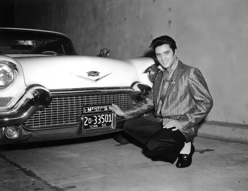 Elvis in 1957 with one of his Cadillacs