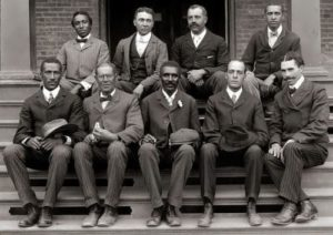 George Washington Carver (bottom row, center) with his friends from the institute, 1902