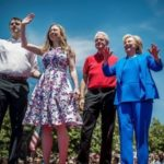 Bill, Hillary, Chelsea Clinton and Marc Mezvinski greet people during a meeting on Roosevelt Island in New York, June 13, 2015