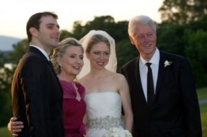 Banker Marc Mezvinski, US Secretary of State Hillary Clinton, Chelsea Clinton and former US President Bill Clinton. July 31, 2010 - wedding of Chelsea and Marc in Reinbek, New York