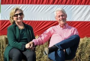 Former US President Bill Clinton and former US Secretary of State Hillary Clinton at the 37th Harkin Steak Fry Festival in Indianola, Iowa, September 14, 2014