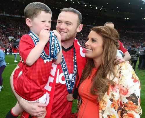 Rooney with his wife and their son