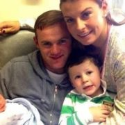 Rooney with his wife and their sons