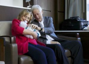 Hillary and Bill Clinton with their granddaughter