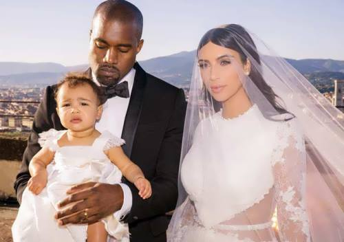Kanye West, Kim Kardashian and their child