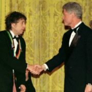 Bill Clinton is awarding Bob Dylan, 1997