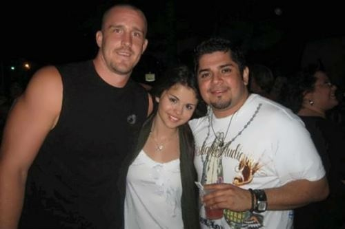 Selena with her father (right) and stepfather (left)