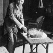 Rockefeller is cutting a birthday cake for his guests on his 90th birthday, July 8, 1929