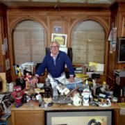 Ray Bradbury in his office in Beverly Hills, surrounded by toys and treasures. January 10, 1986