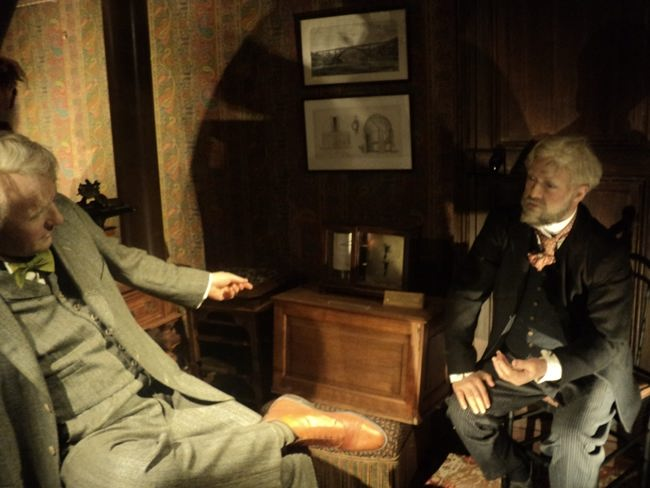 Wax figures of Eiffel (right) and Edison