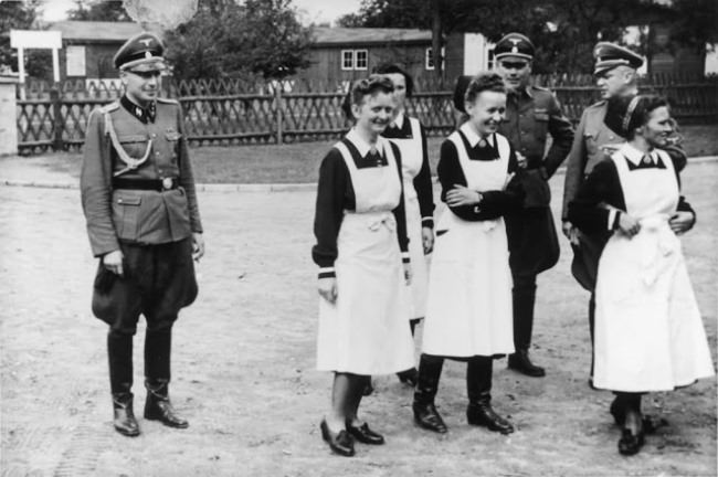 33-year-old doctor Josef Mengele with co-workers in Auschwitz