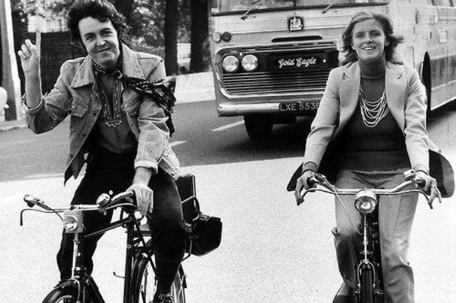 Riding bikes. Paul and Linda McCartney