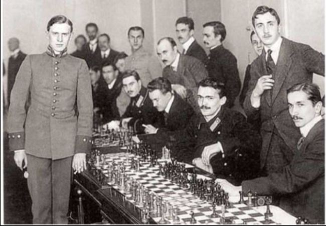 Alexander Alekhine (left) in the uniform of a student of the Imperial School of Law at the St. Petersburg tournament